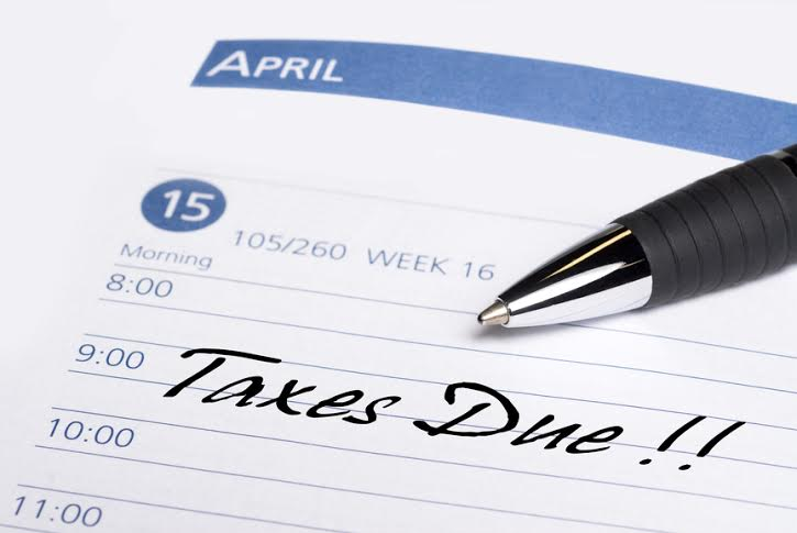 A date book communicates a reminder that taxes are due on April 15th.